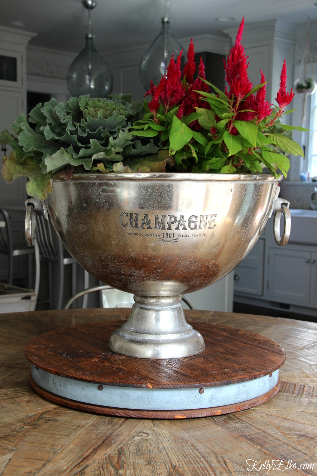 Get creative with your planters - this champagne bucket makes a fun fall planter kellyelko.com