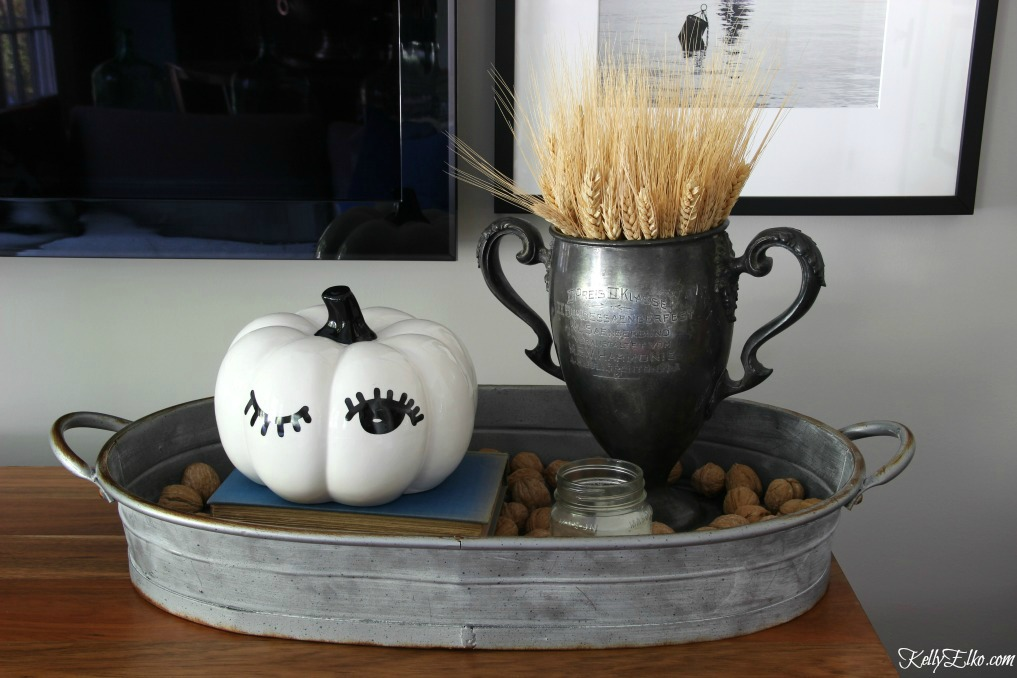 Winking pumpkin and vintage trophy filled with wheat for fall kellyelko.com