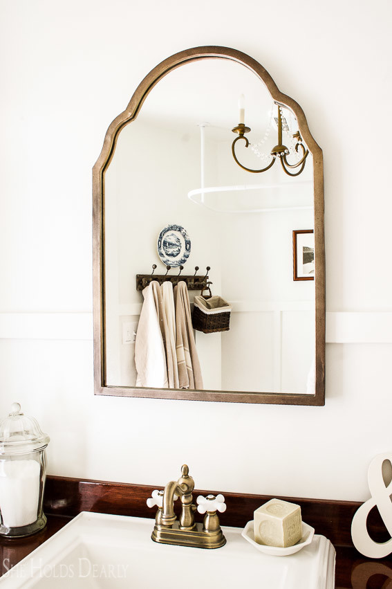 Farmhouse tour - love the brass faucet and mirror in this bathroom
