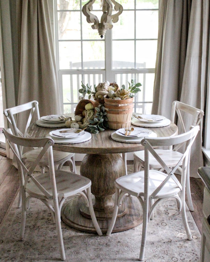 Farmhouse tour - love this round dining table set for fall