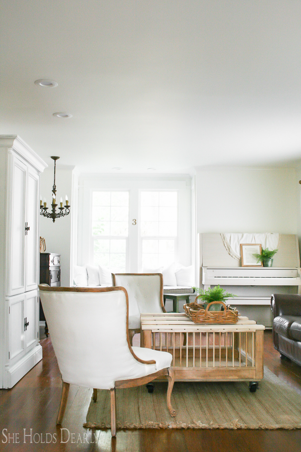 Farmhouse tour - love the white walls with touches of warm wood and the chicken coop coffee table