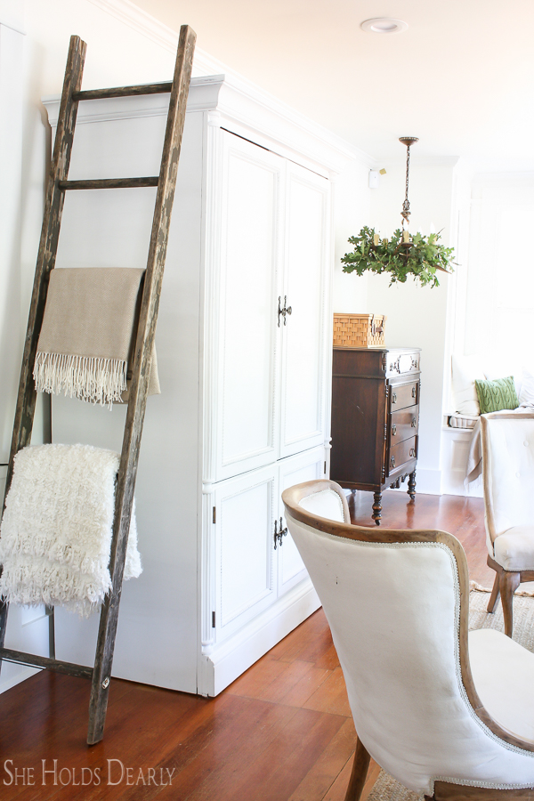 Farmhouse tour - love the old ladder for displaying blankets