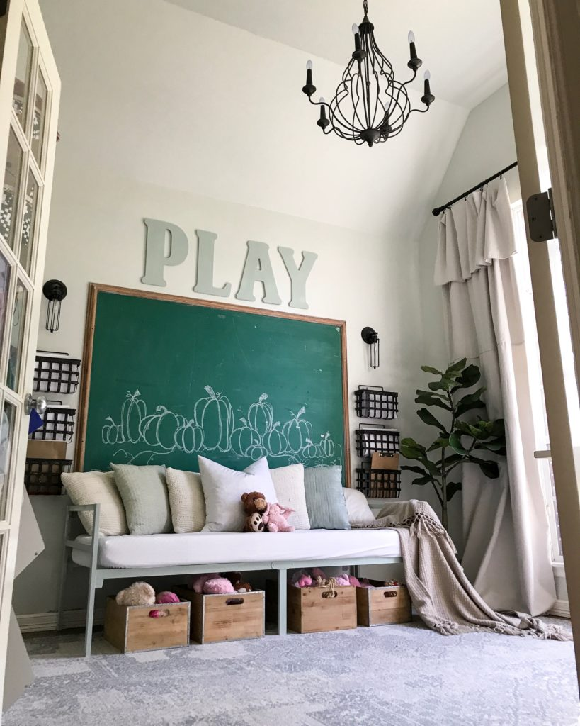 Farmhouse tour - love the giant green chalkboard in this playroom