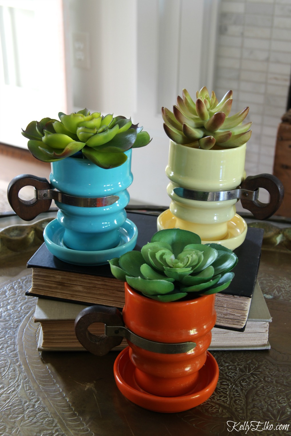 Love this trio of vintage metlox mugs filled with succulents kellyelko.com