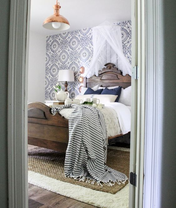 Farmhouse tour - love this vintage modern bedroom with cement tile wallpaper and antique copper light