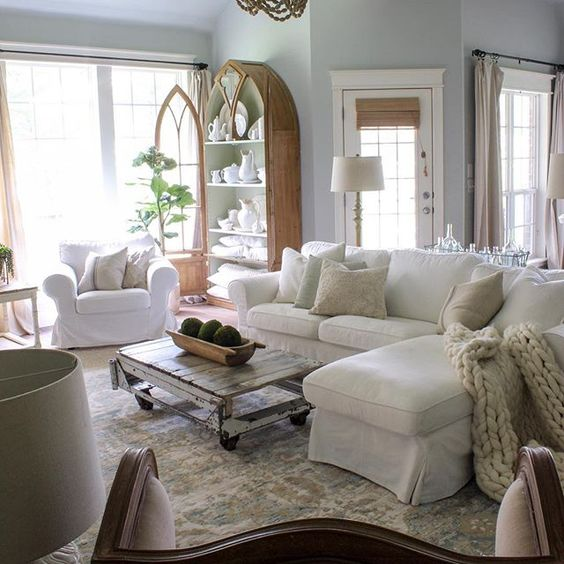 Farmhouse tour - love this neutral family room with white sofa and antique furniture