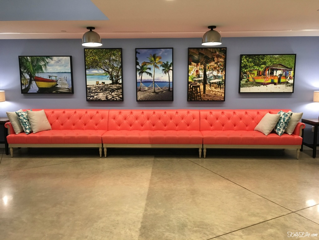 Pink sofa with tropical artwork kellyelko.com