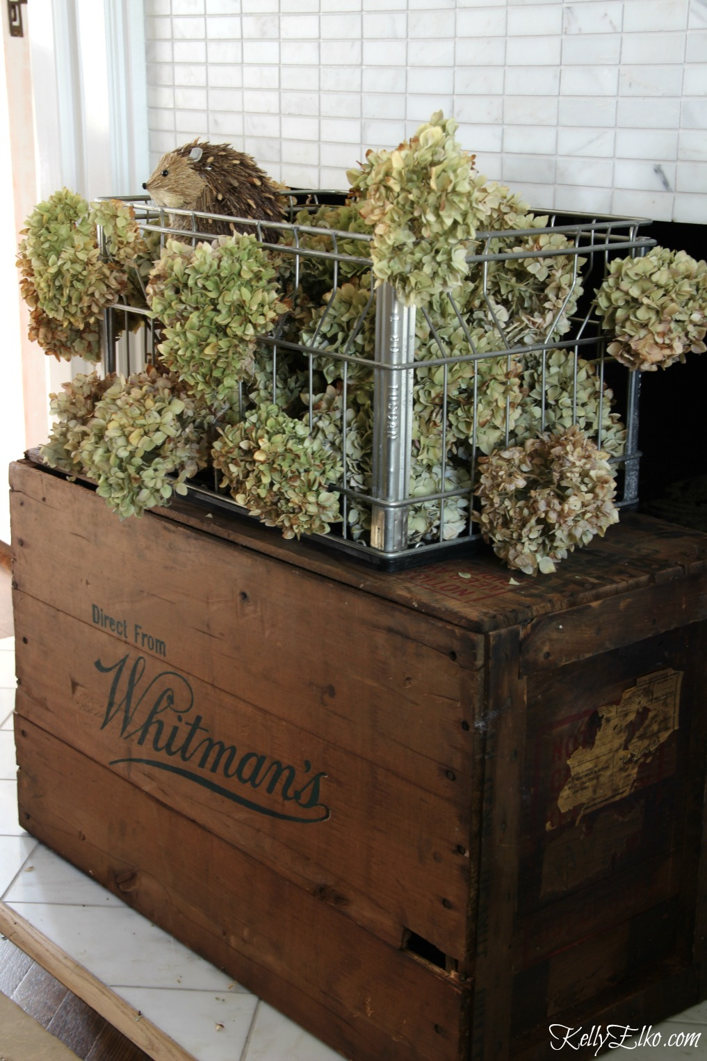 Vintage milk crate filled with dried hydrangeas kellyelko.com