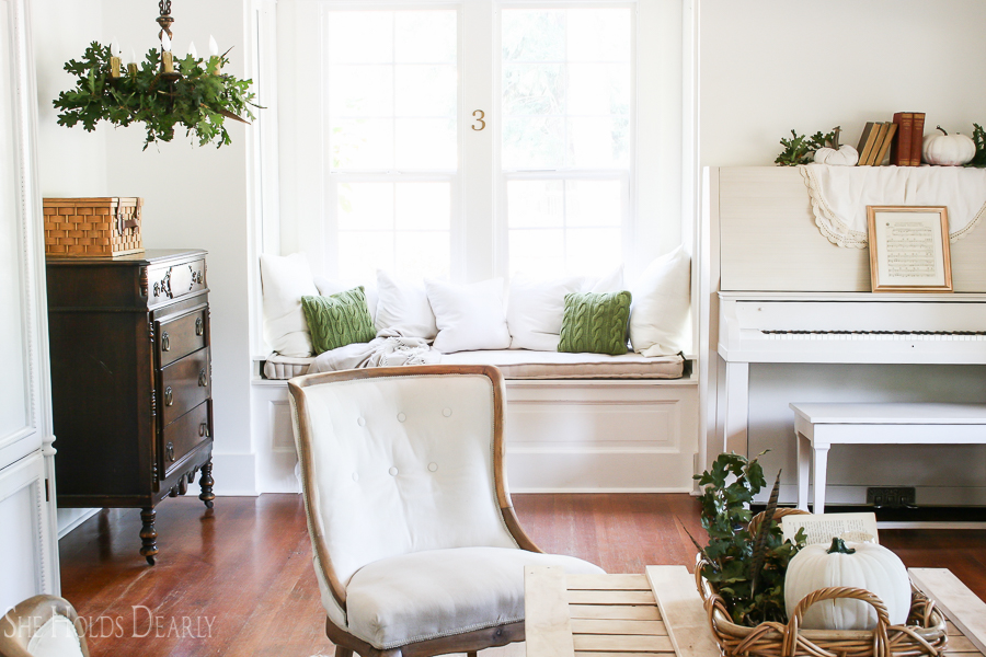 Farmhouse tour - love the cozy window seat in the living room