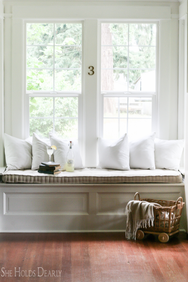 Farmhouse tour - love the cozy upholstered window seat