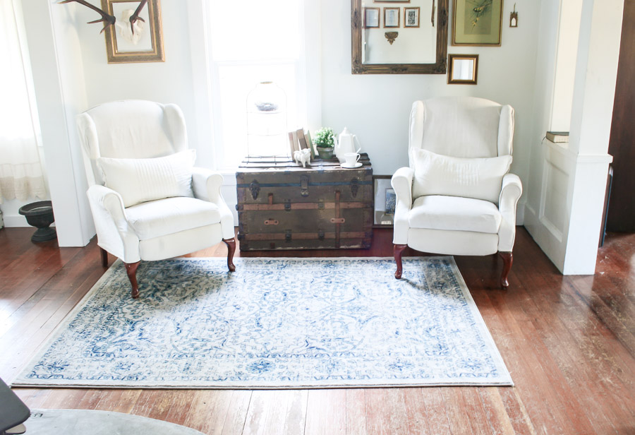 Farmhouse tour - love the pair of wingback chair and antique trunk