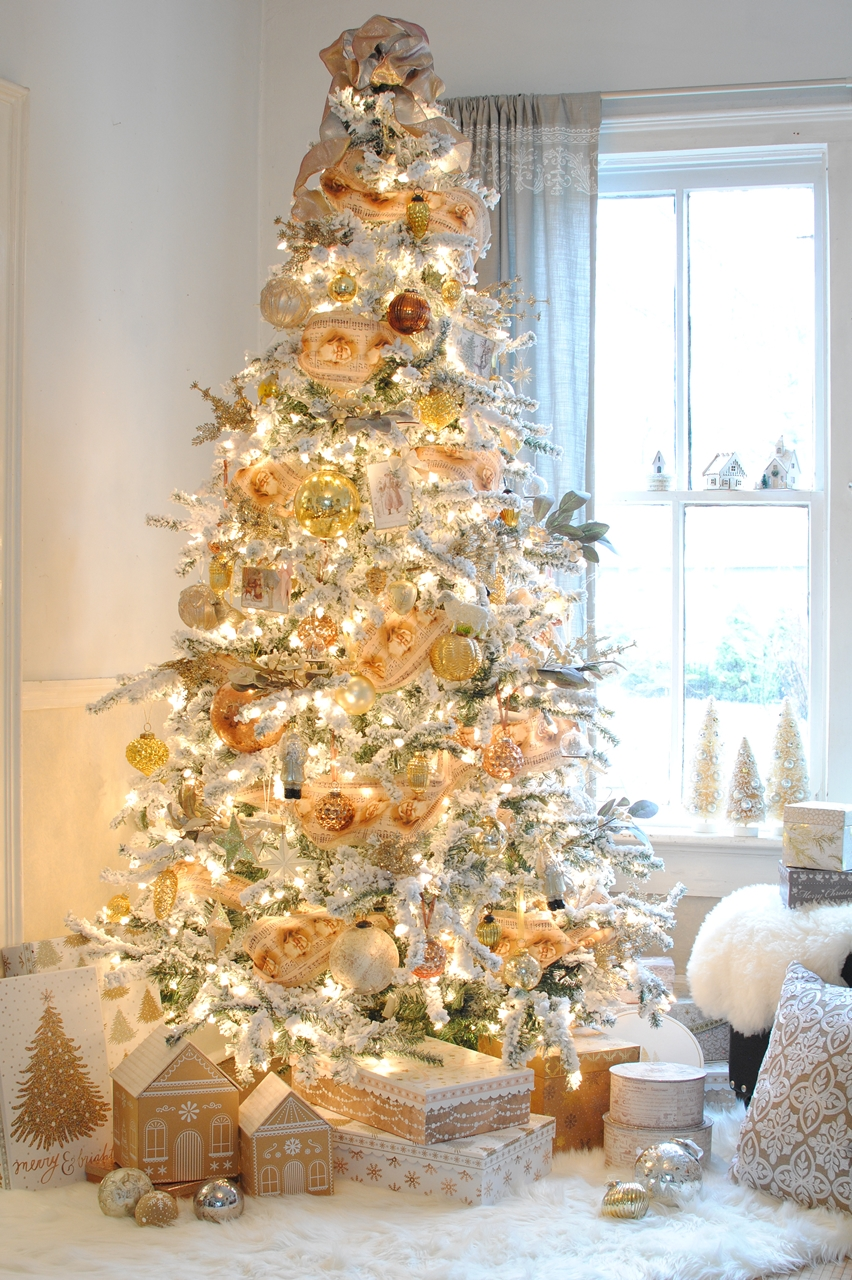 Creative Christmas Decorating Ideas - love this beautiful flocked Christmas tree with vintage ribbon