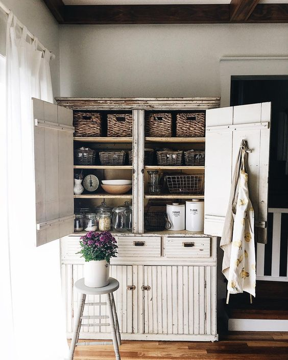 Farmhouse Tour - love this primitive cabinet for storage