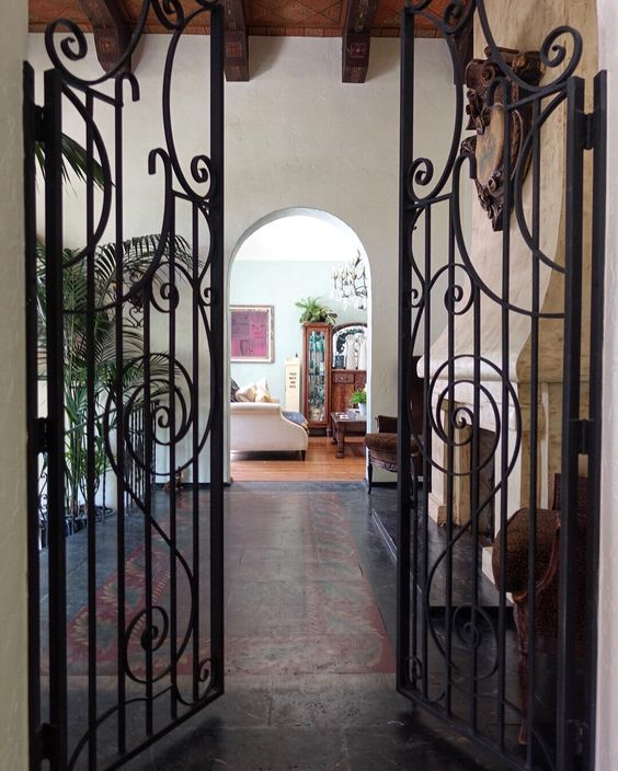 1927 house tour - love the antique iron gates, wood beam ceiling and tile floor