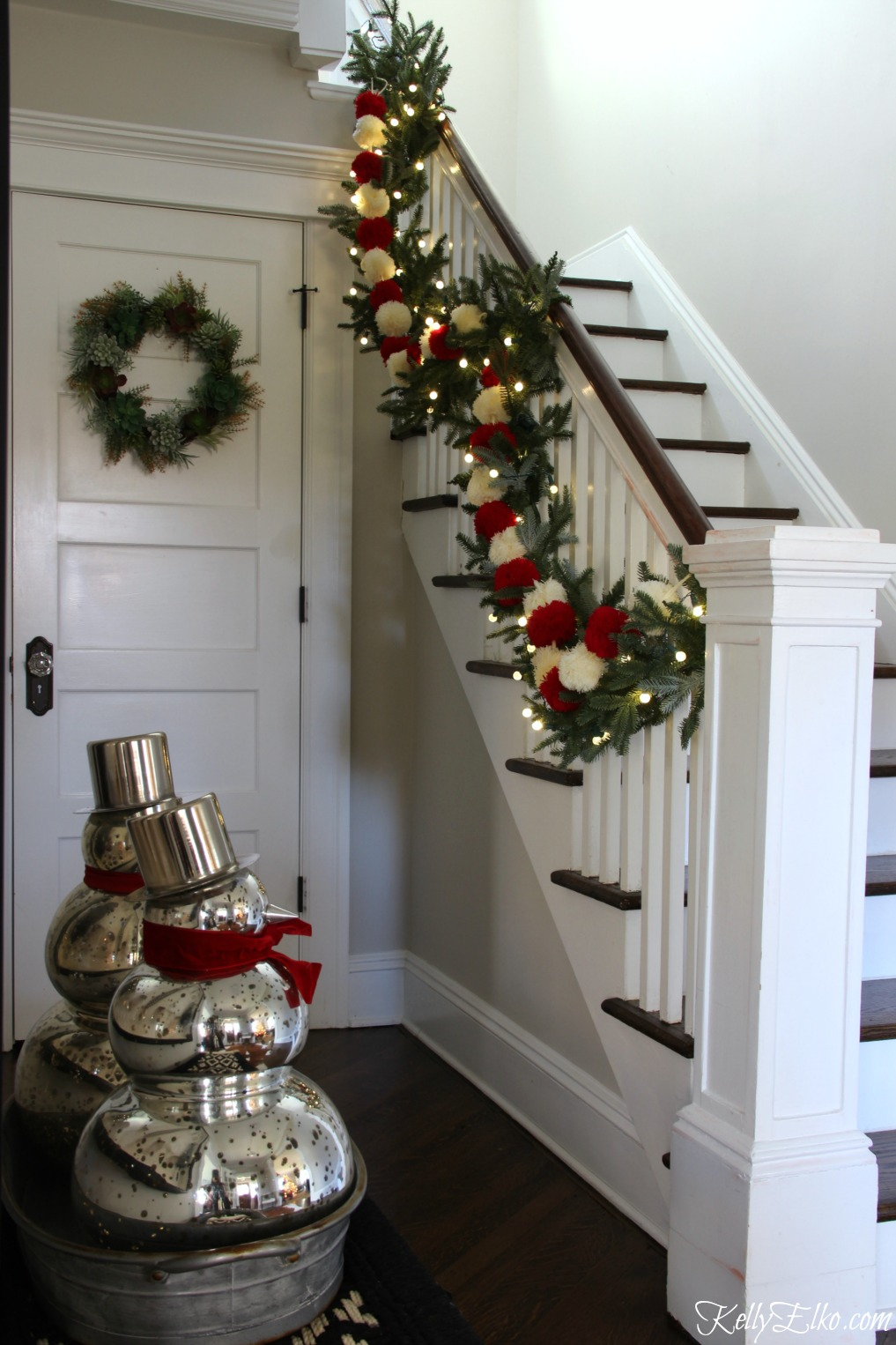 Christmas Home Tour - love this foyer with pom pom garland kellyelko.com