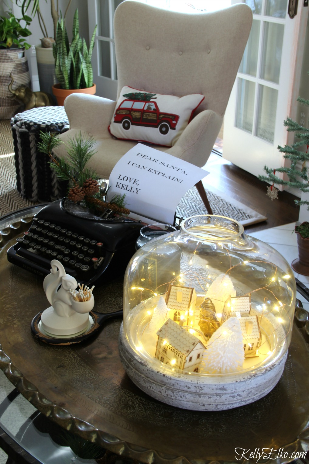 Love the vintage typewriter with a letter from Santa and the winter village jar filled with fairy lights kellyelko.com #christmas #vintagechristmas #christmasdecor #diychristmasdecor #terrarium #christmasdecorating #kellyelko