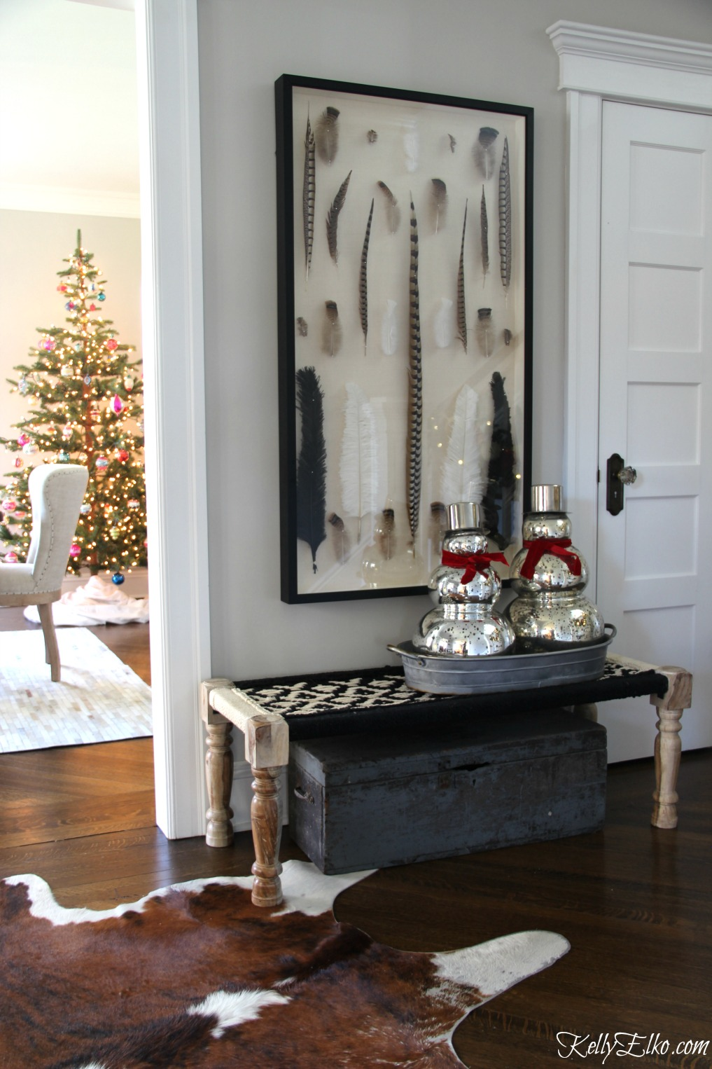 Christmas Home Tour - love this festive foyer with mercury glass snowmen kellyelko.com