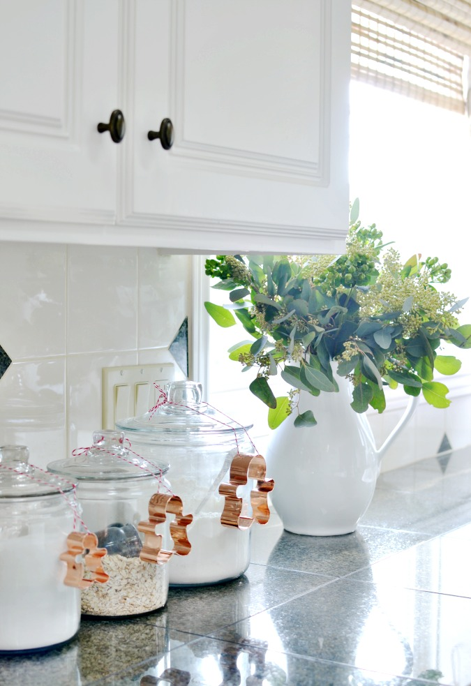 Creative Christmas Decorating Ideas - love the simplicity of tying cookie cutters to jars in the kitchen
