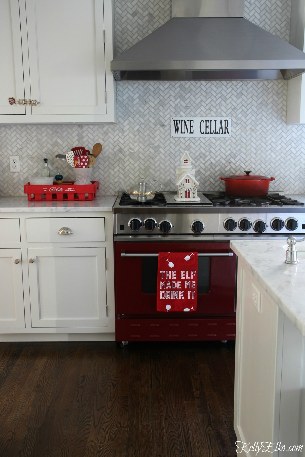 Christmas Kitchen - love the red stove and touches of red for a festive look kellyelko.com