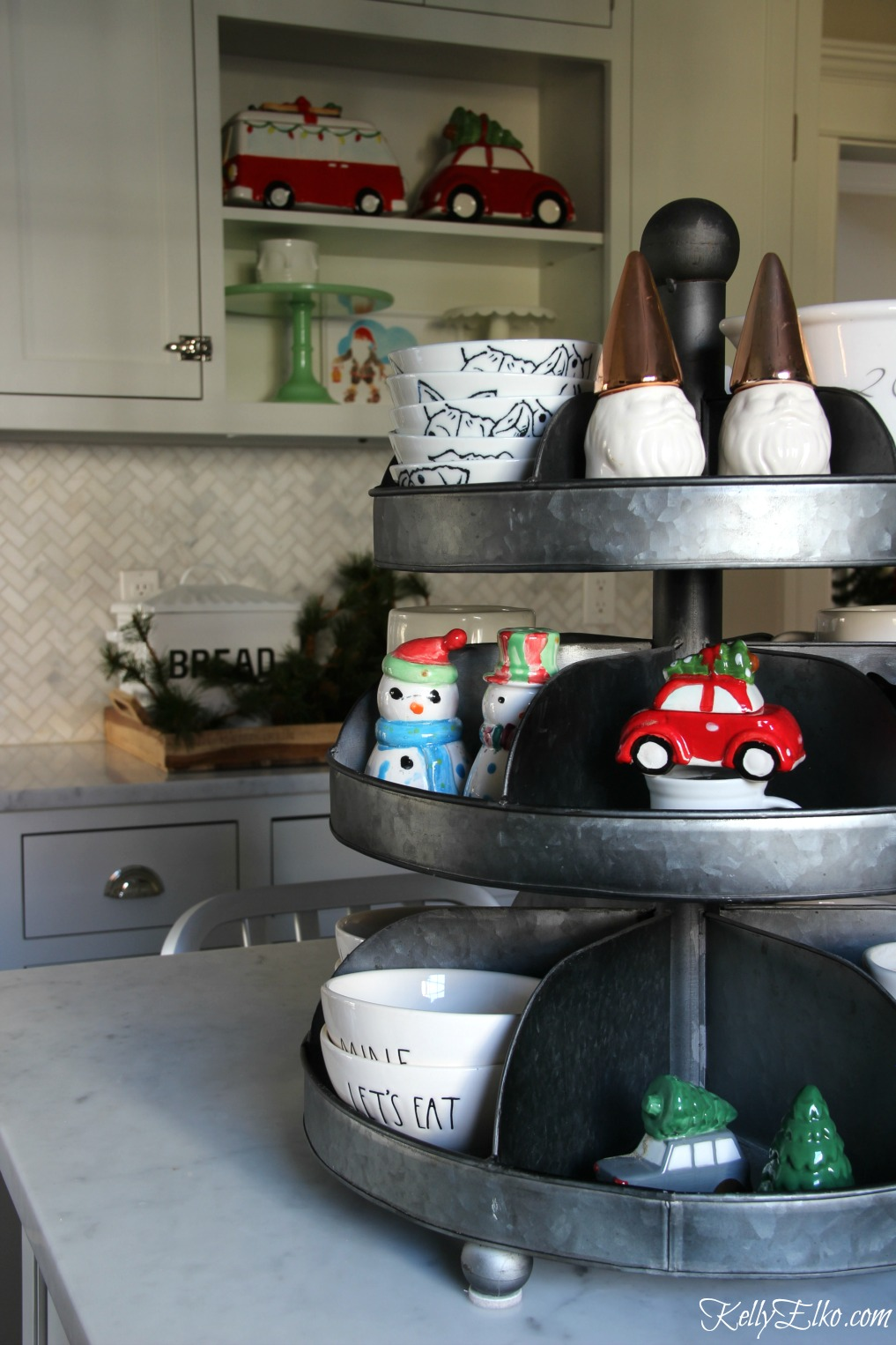 Christmas Kitchen - love this galvanized tiered tray for displaying everyday items and Christmas salt and pepper shakers kellyelko.com