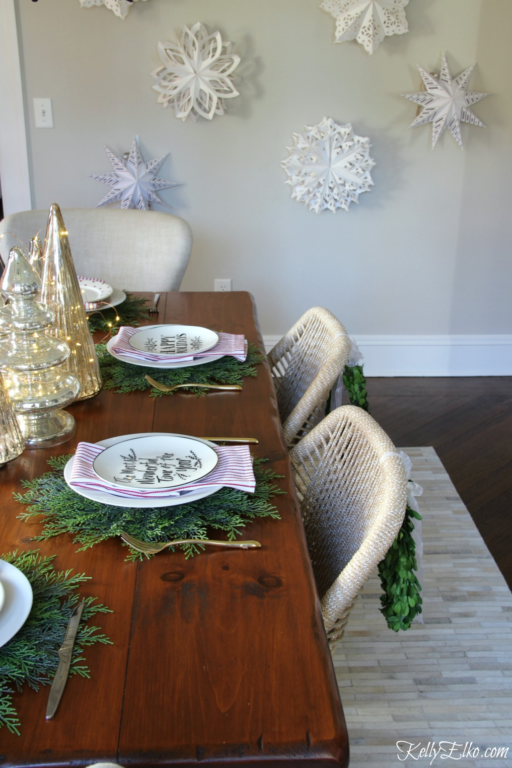 Christmas Home Tour - love the wall of paper snowflakes kellyelko.com