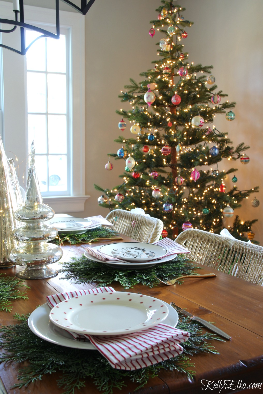 Christmas Home Tour - love this table setting with cedar placemats! kellyelko.com