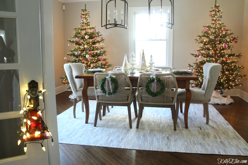 Christmas Home Tour - love the pair of Christmas trees in the dining room kellyelko.com