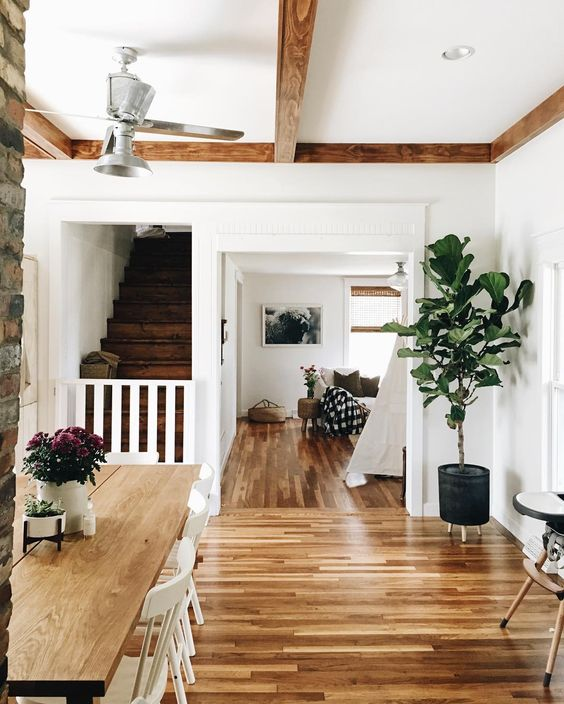 Farmhouse Tour - love the wood floors and beams with white walls
