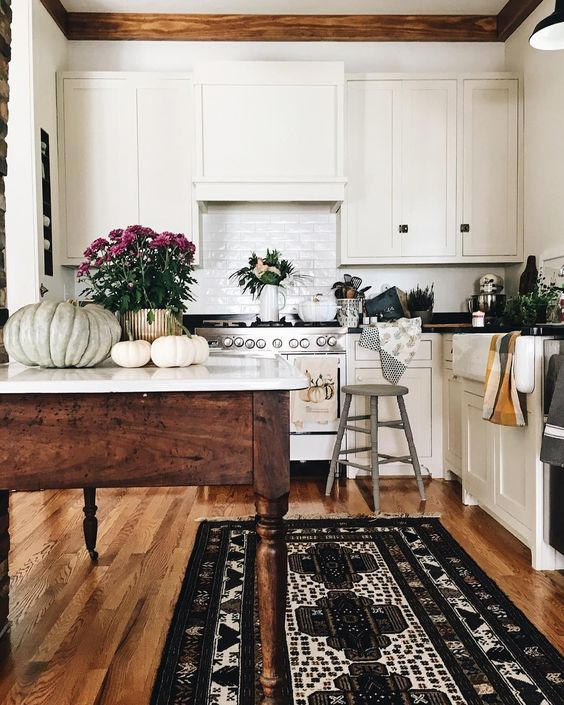 Farmhouse Tour - love this classic white kitchen with wood table island