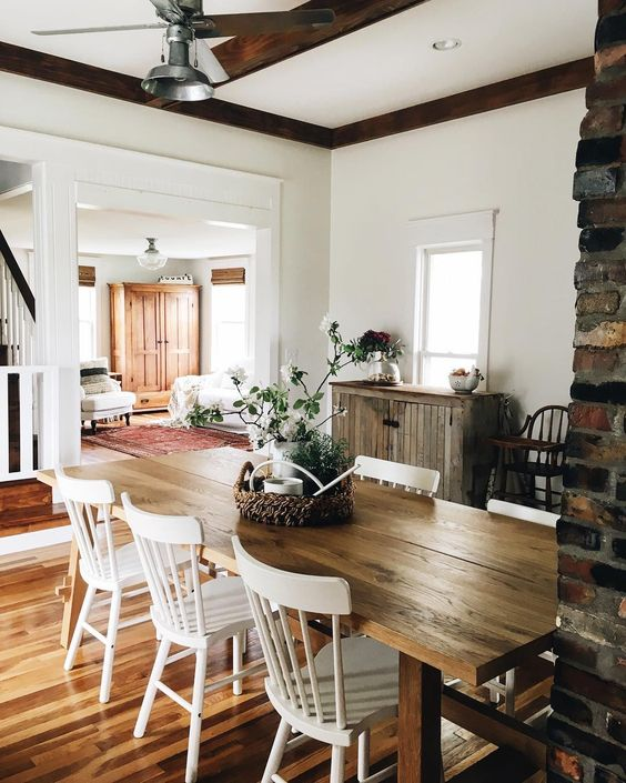 Farmhouse Tour - love the big wood table and white chairs