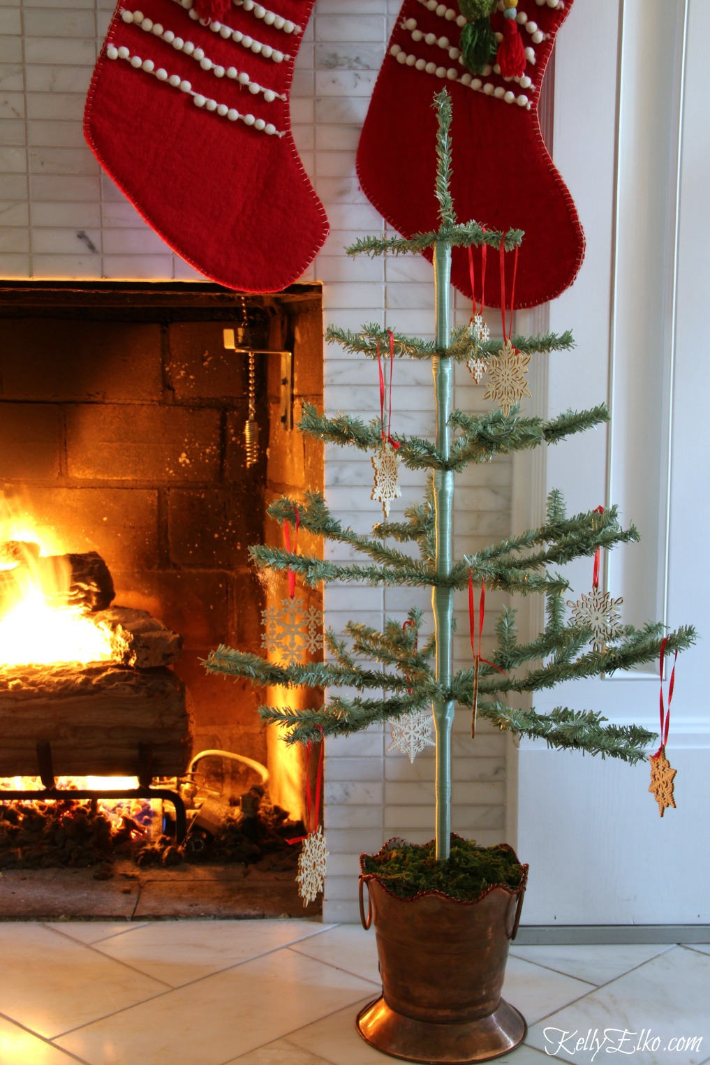 Christmas Home Tour - love this little feather tree kellyelko.com