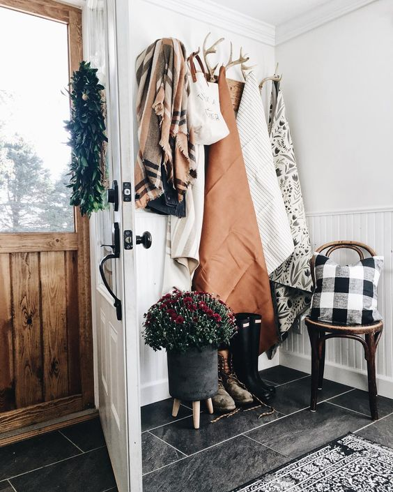 Farmhouse Tour - love the antler coat hooks in this entry