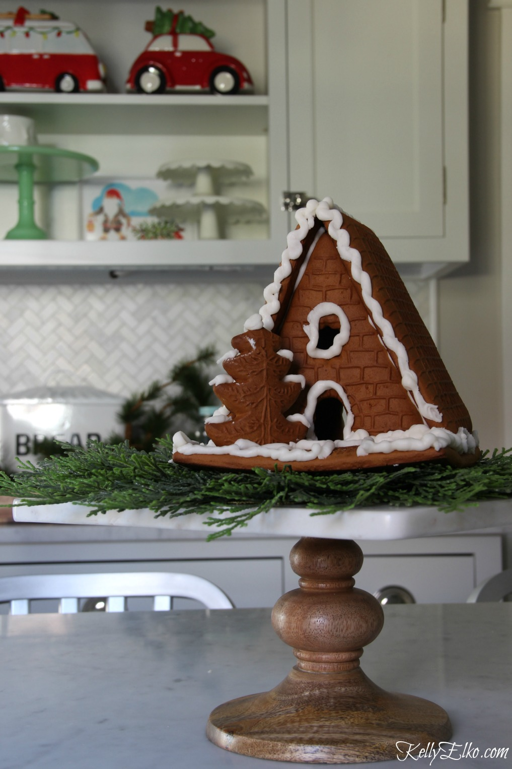 Christmas Kitchen - love the cute little gingerbread house on a cake stand kellyelko.com