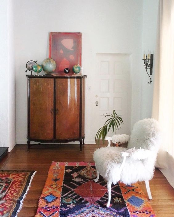Eclectic Home Tour - love the colorful rugs and fur chair