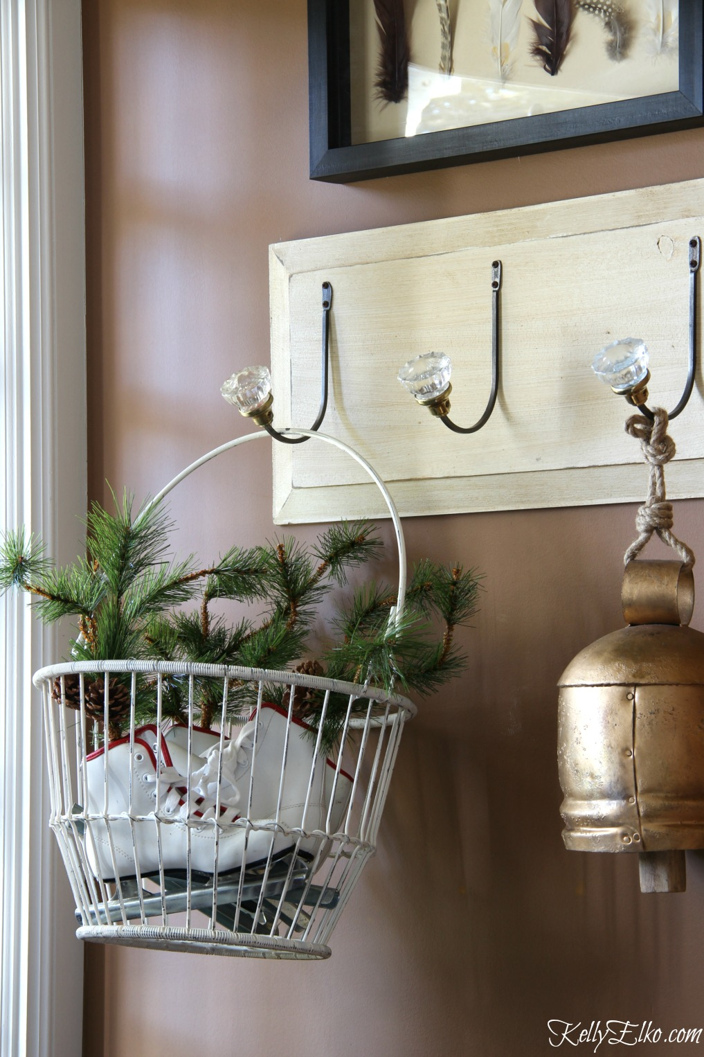 Christmas Home Tour - love this basket filled with ice skates kellyelko.com