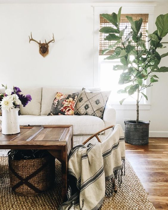 Farmhouse Tour - love this cozy sofa and old door turned coffee table