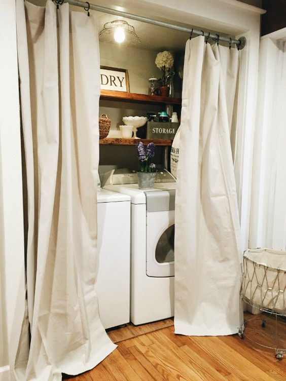 Farmhouse Tour - closet laundry room with curtains