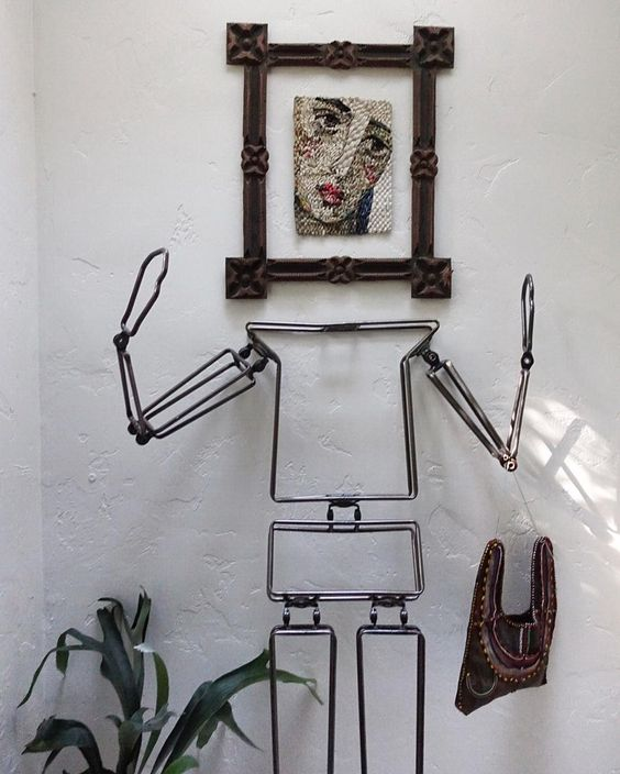 How fun - and iron body form with framed art as the head