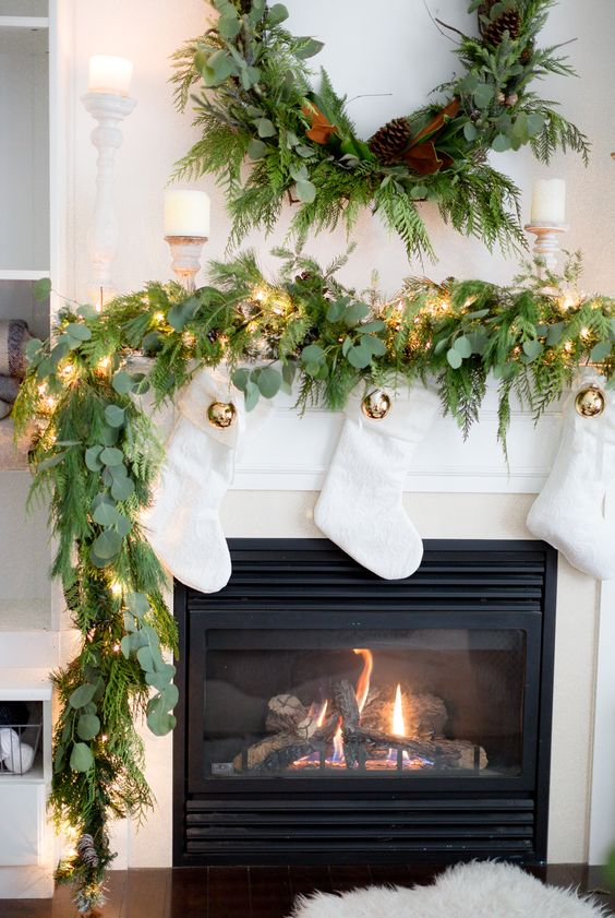 Creative Christmas Decorating Ideas - love this gorgeous real garland and white stockings