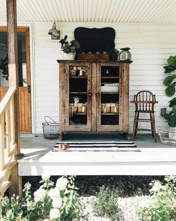 Farmhouse tour - love the porch with primitive cabinet