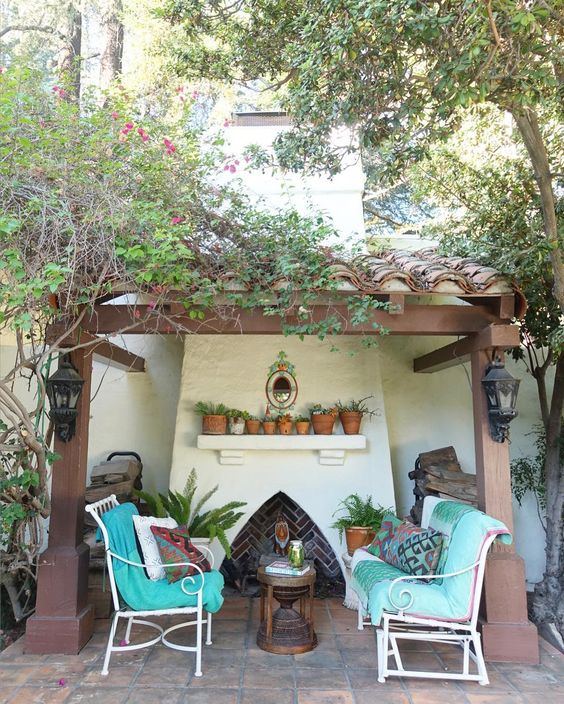 Spanish clay tiles on the roof add a quiet little spot for an outdoor fireplace