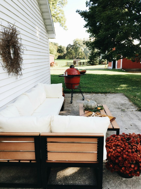 Farmhouse Tour - love this patio with sectional sofa and of course that red barn!