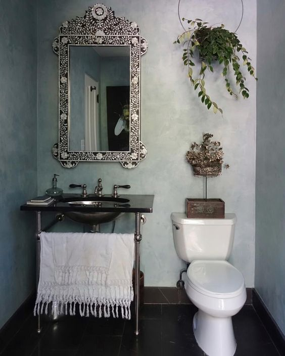 Powder room with chrome leg sink and bone inlay mirror