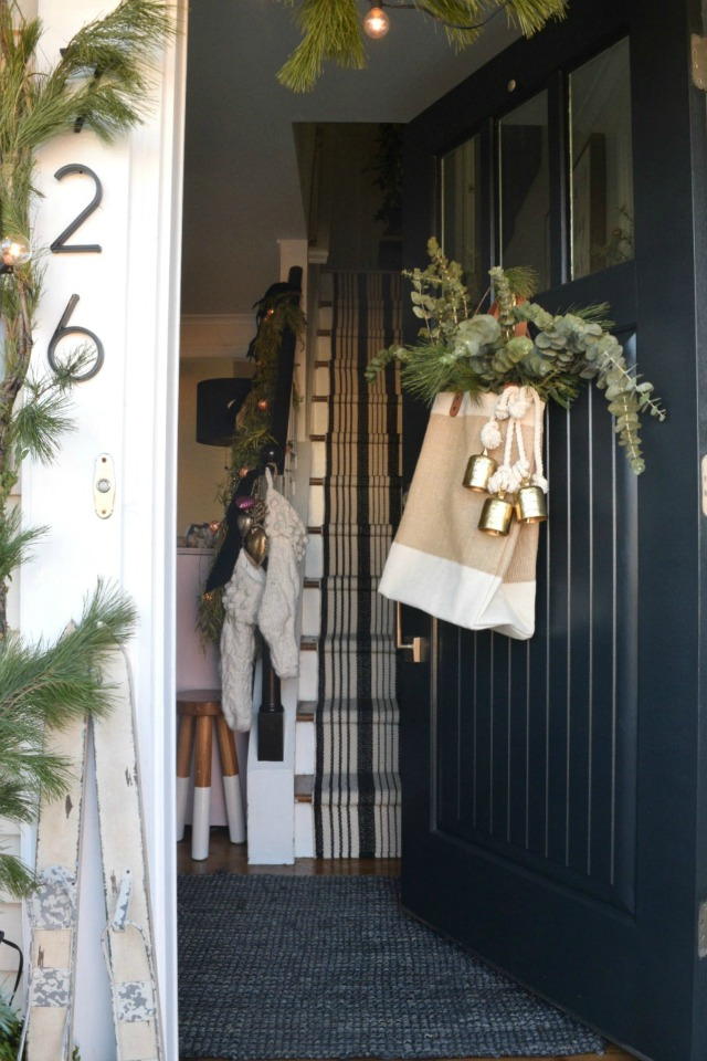 Creative Christmas Decorating Ideas - love this bag filled with greenery instead of the typical front door wreath