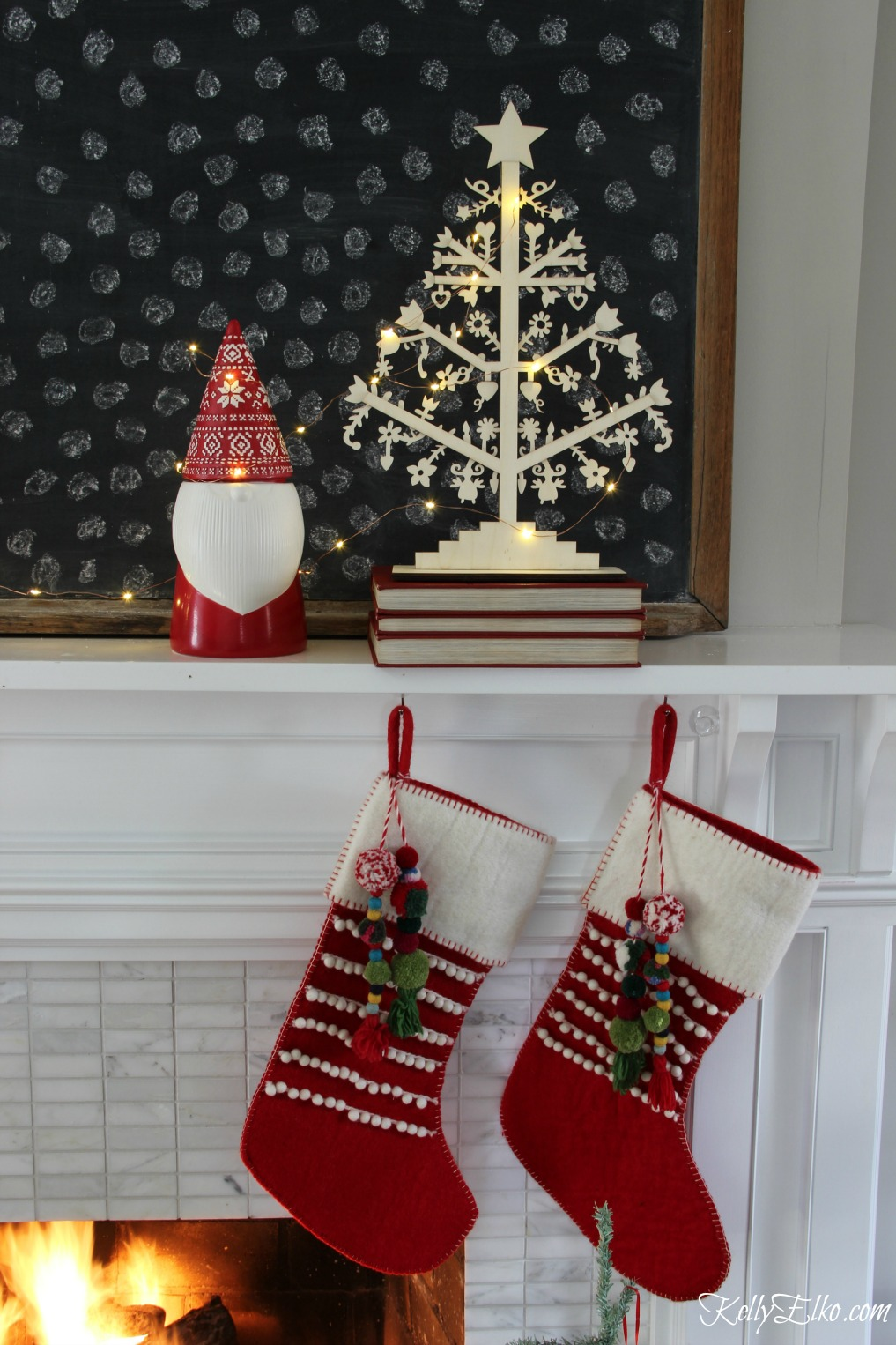 Christmas Home Tour - love this mantel with gnome and pom pom stockings kellyelko.com