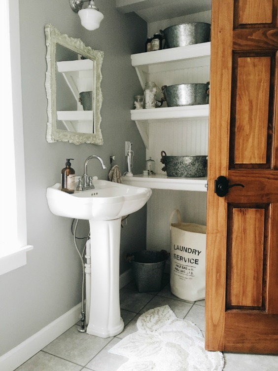 Farmhouse Tour - love this simple white bathroom with open shelves