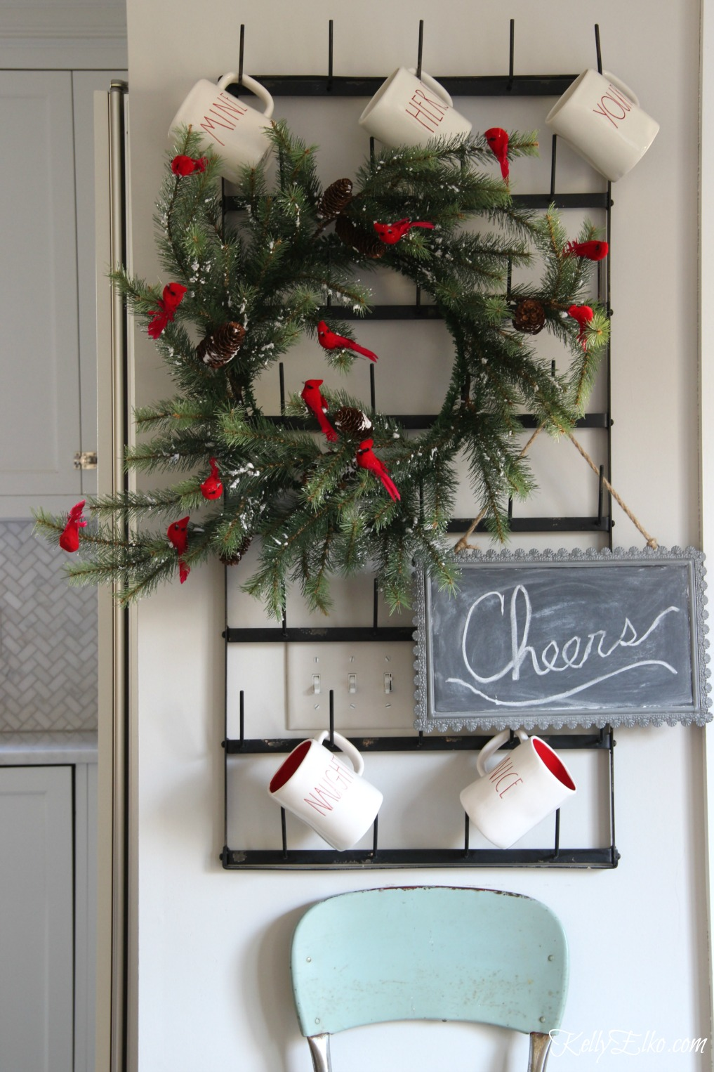 Christmas Kitchen - love this wall mounted bottle drying rack for displaying mugs and a festive wreath kellyelko.com