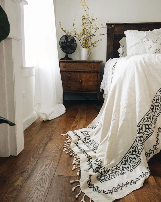 Farmhouse Tour - love the white bedding against dark wood headboard and floors