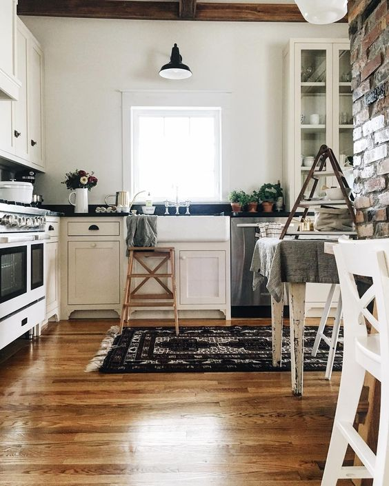 Farmhouse Tour - love this white kitchen with wood floors