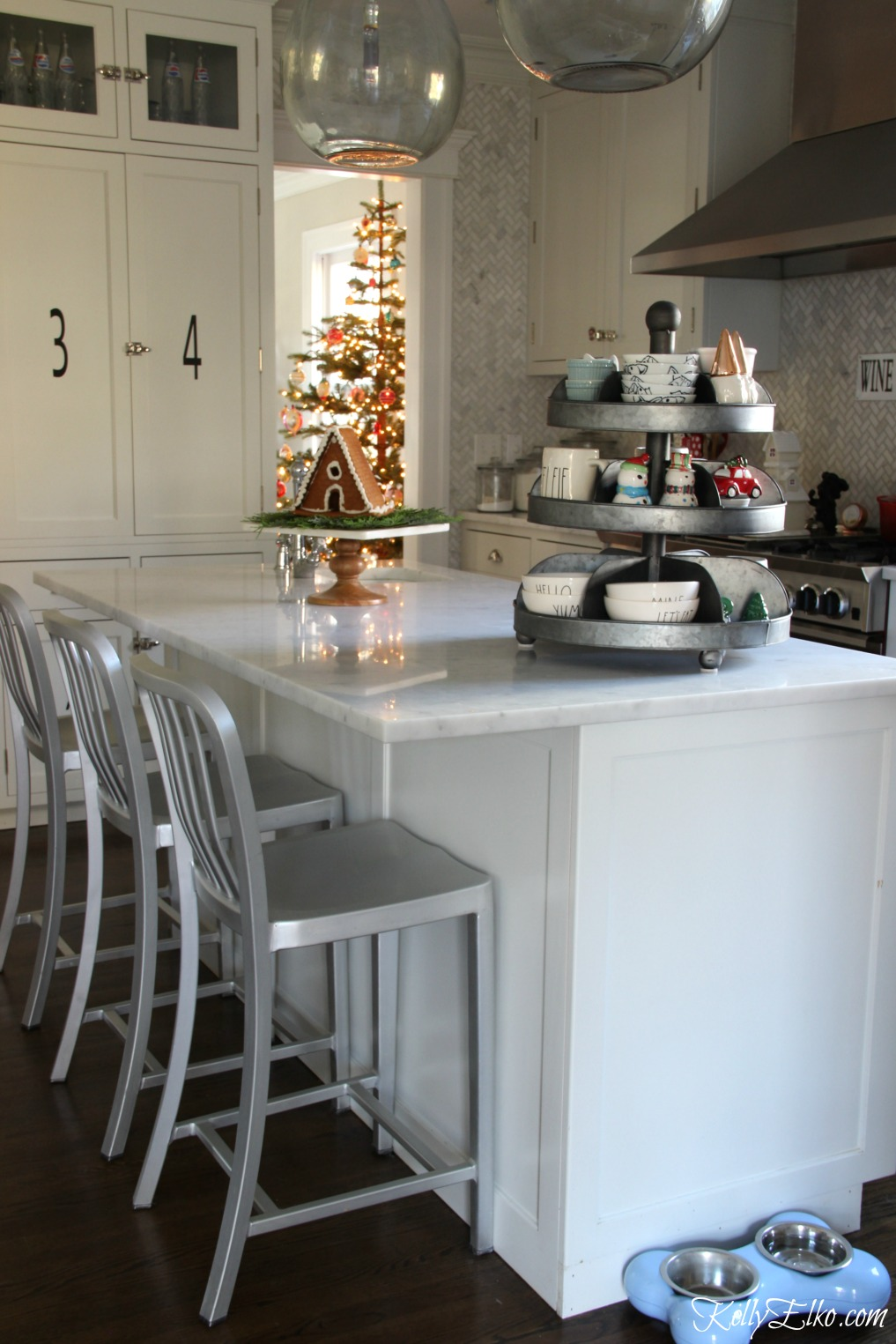 Kitchen Christmas Decorating Ideas - love this white kitchen filled with festive touches kellyelko.com